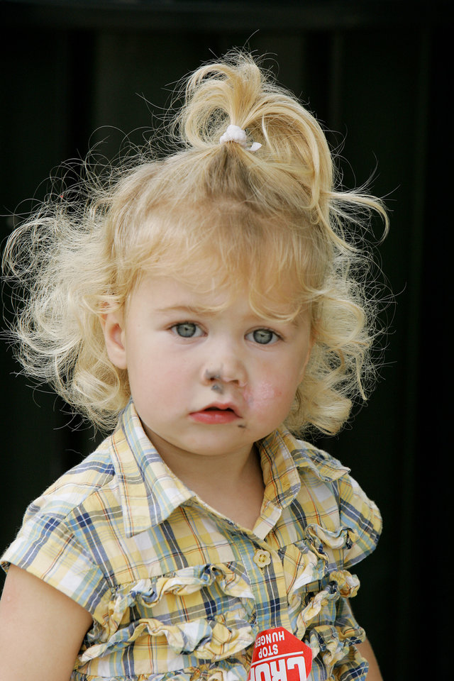 Myleigh Beard 23mths, of Norman has a little chalk on her face from helping her sisters in the Cleveland county CROP walk to stop hunger Sidewalk Chalk Art contest for Kids and Families Saturday, Sept. 13, at the Santa Fe Depot in Norman,OK. BY JACONNA AGUIRRE, THE OKLAHOMAN.