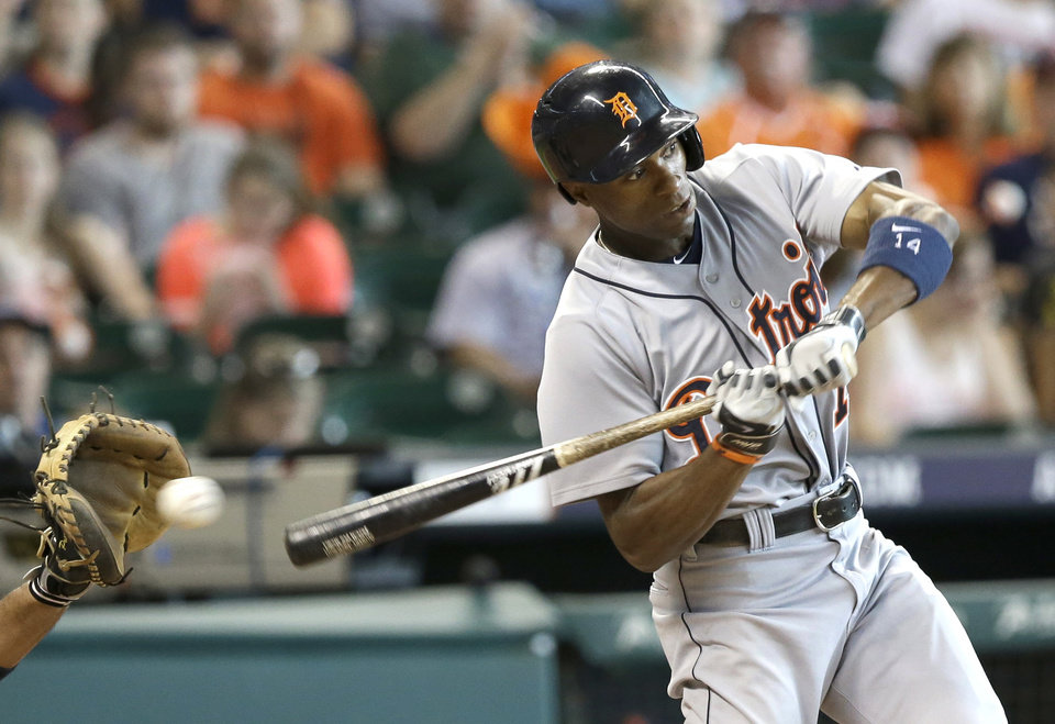 Photo - Detroit Tigers' Austin Jackson swings for strike three to end the top of the seventh inning of a baseball game against the Houston Astros, Sunday, June 29, 2014, in Houston. (AP Photo/Pat Sullivan)