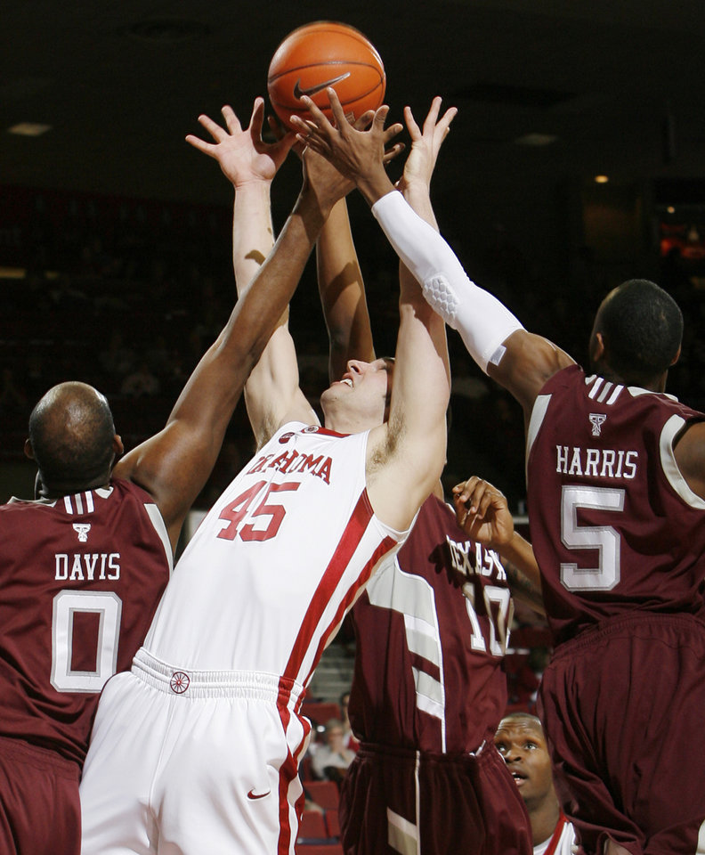 OU\'s Beau Gerber (45) attempts to rebound the ball between Bryan Davis (0), David Loubeau (10) and Dash Harris (5) of Texas A&M in the first half during the men\'s college basketball game between the Oklahoma Sooners and Texas A&M Aggies at Lloyd Noble Center in Norman, Okla., Saturday, March 6, 2010. Photo by Nate Billings, The Oklahoman