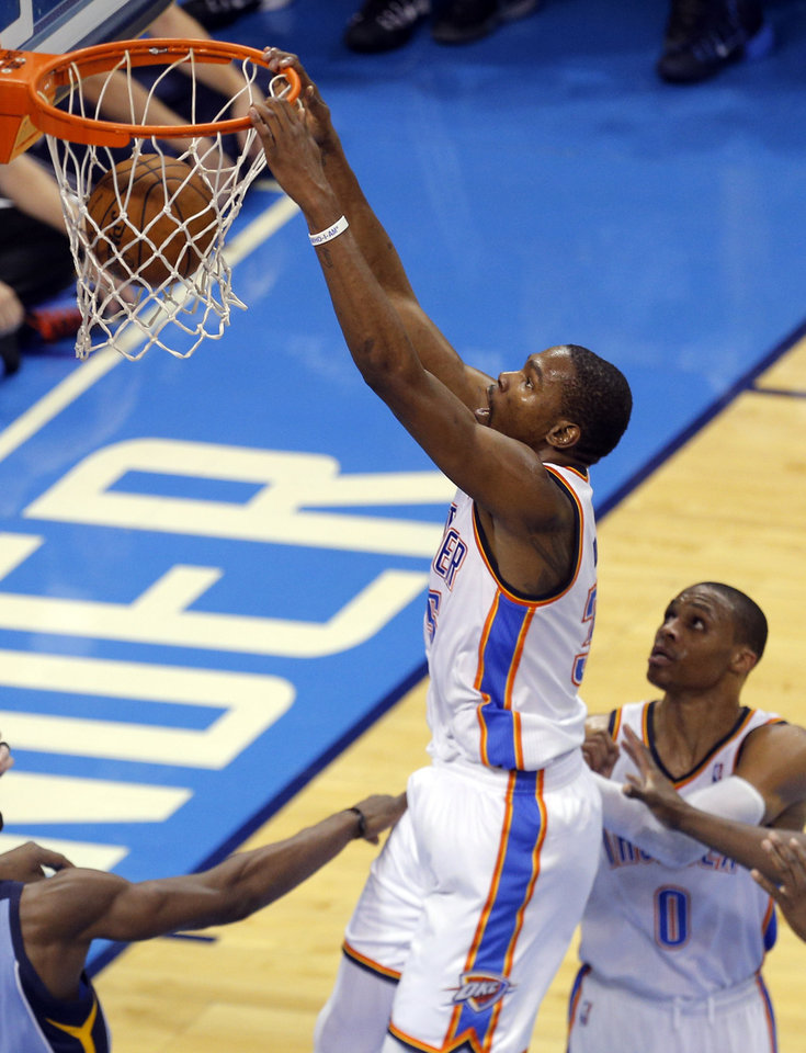 Photo - Oklahoma City's Kevin Durant (35) dunks as Russell Westbrook (0) looks on during Game 2 in the first round of the NBA playoffs between the Oklahoma City Thunder and the Memphis Grizzlies at Chesapeake Energy Arena in Oklahoma City, Monday, April 21, 2014. Photo by Sarah Phipps, The Oklahoman