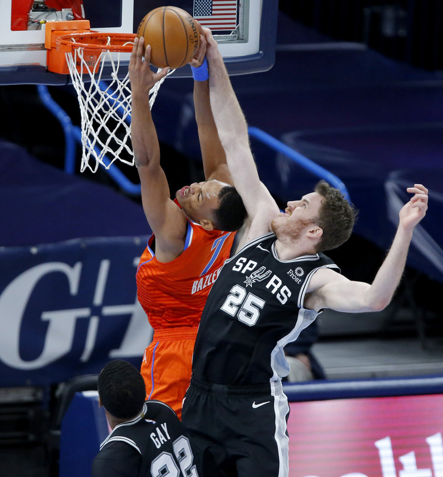 Photo - Oklahoma City's Darius Bazley (7) is fouled by San Antonio's Jakob Poeltl (25) during an NBA basketball game between the Oklahoma City Thunder and the San Antonio Spurs at Chesapeake Energy Arena in Oklahoma City, Tuesday, Jan. 12, 2021. [Bryan Terry/The Oklahoman]