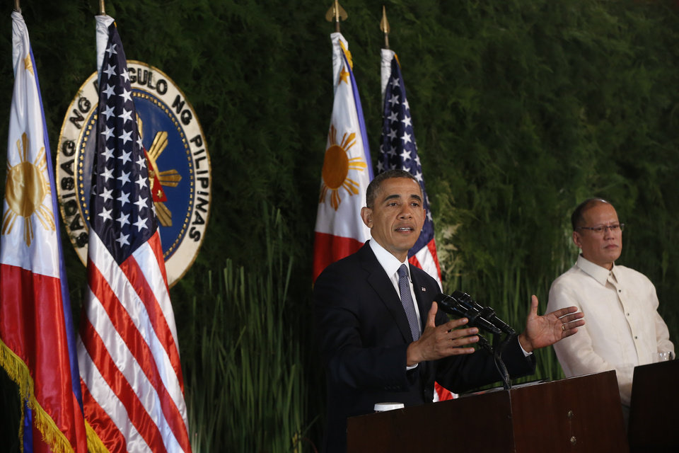 Photo - U.S. President Barack Obama and Philippines President Benigno Aquino III speak at a joint news conference at Malacanang Palace in Manila, the Philippines, Monday, April 28, 2014. President Obama said a 10-year agreement signed Monday to give the U.S military greater access to Philippine bases will help promote regional security, improve armed forces training and shorten response times to humanitarian crises, including natural disasters. (AP Photo/Charles Dharapak)