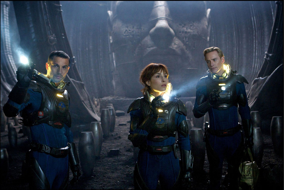 Photo - From left, Logan Marshall-Green, left, Noomi Rapace, and Michael Fassbender explore a planet in the darkest corners of the universe in Ridley Scott's