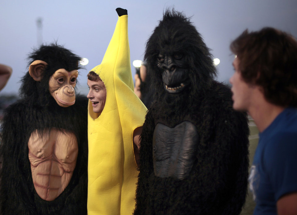 Asher Holloman stands with a monkey and gorilla before the high school football game between Deer Creek and Carl Albert at Deer Creek High School, Friday, Sept. 21, 2012.  Photo by Sarah Phipps, The Oklahoman