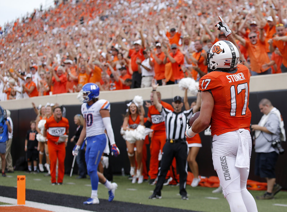 Photo - Oklahoma State's Dillon Stoner (17) celebrates a touchdown in the third quarter during a college football game between the Oklahoma State Cowboys (OSU) and the Boise State Broncos at Boone Pickens Stadium in Stillwater, Okla., Saturday, Sept. 15, 2018. OSU won 44-21. Photo by Sarah Phipps, The Oklahoman