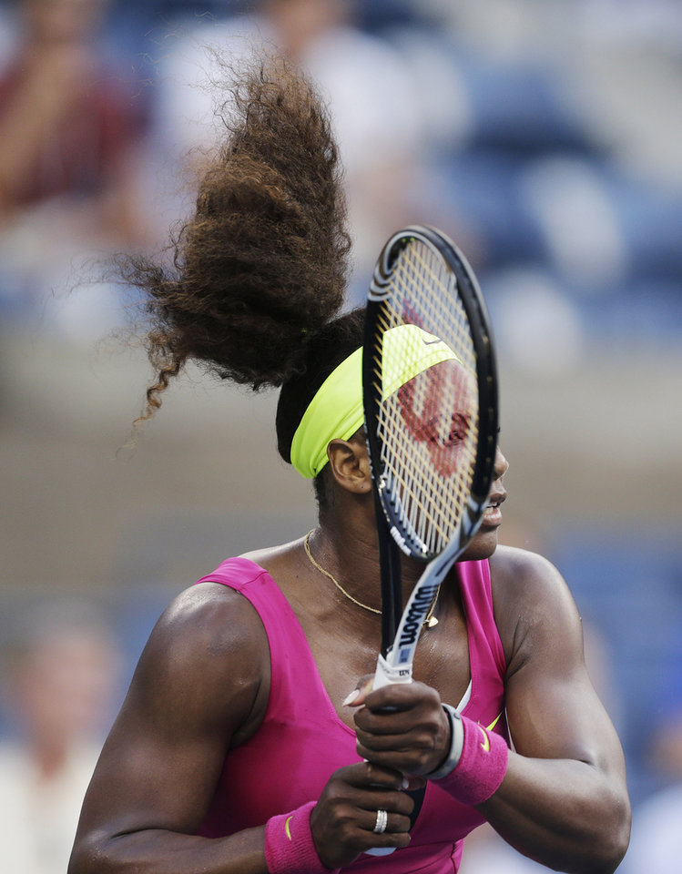 Photo -   Serena Williams returns a shot to Italy's Sara Errani during a semifinal match at the 2012 US Open tennis tournament, Friday, Sept. 7, 2012, in New York. (AP Photo/Charles Krupa)