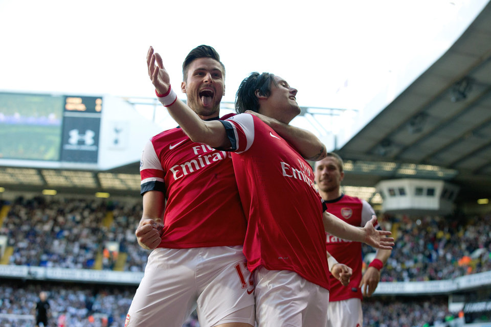Photo - Arsenal's Tomas Rosicky, right, celebrates scoring with teammate Olivier Giroud during the English Premier League soccer match between Tottenham Hotspur and Arsenal at White Hart Lane stadium in London, Sunday, March 16, 2014. (AP Photo/Matt Dunham)