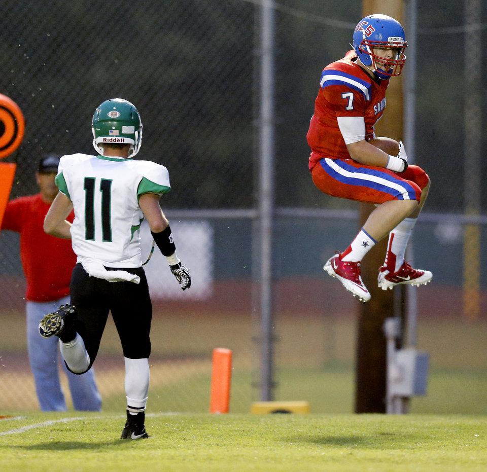 Blake Barnes of Oklahoma Christian School (OCS) celebrates as he scores a touchdown in front of Cody Noll of Jones during a high school football game in Edmond, Friday, September 14, 2012. Photo by Bryan Terry, The Oklahoman