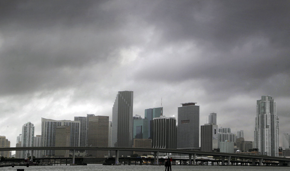 Heavy storm clouds hover over the skyline of downtown Miami as Tropical Storm Isaac\'s weather bands reach the Miami area aon Sunday, Aug. 26, 2012. Isaac gained fresh muscle Sunday as it bore down on the Florida Keys, with forecasters warning it could grow into a dangerous Category 2 hurricane as it nears the northern Gulf Coast. (AP Photo/The Miami Herald, Carl Juste) ORG XMIT: FLMIH101