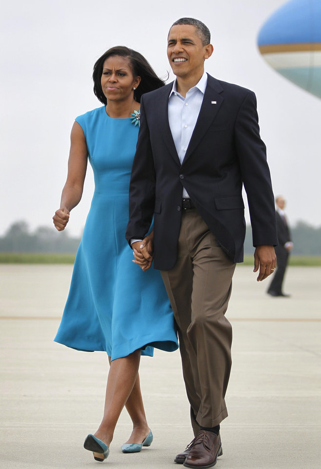 Photo -   President Barack Obama and first lady Michelle Obama arrive at Rickenbacker International Airport, Saturday, May 5, 2012, in Columbus, Ohio. (AP Photo/Haraz N. Ghanbari)