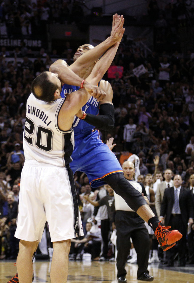 Photo - Oklahoma City's Russell Westbrook (0) runs into San Antonio's Manu Ginobili (20) after shooting during Game 2 of the Western Conference Finals in the NBA playoffs between the Oklahoma City Thunder and the San Antonio Spurs at the AT&T Center in San Antonio, Wednesday, May 21, 2014. Photo by Sarah Phipps