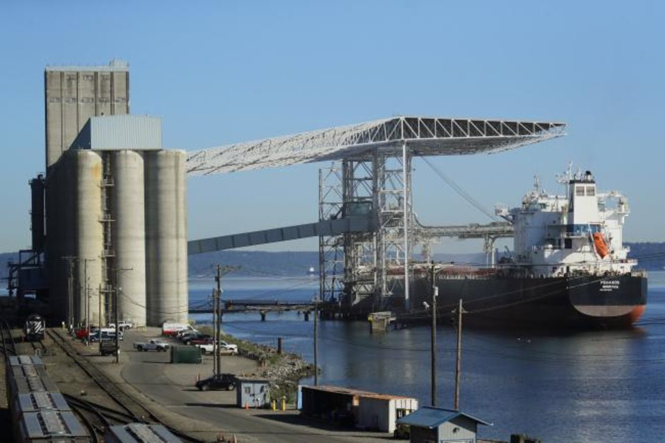 Photo -  A bulk carrier ship is loaded at the Temco grain terminal at the Port of Tacoma in Tacoma, Wash. [AP PHOTO]