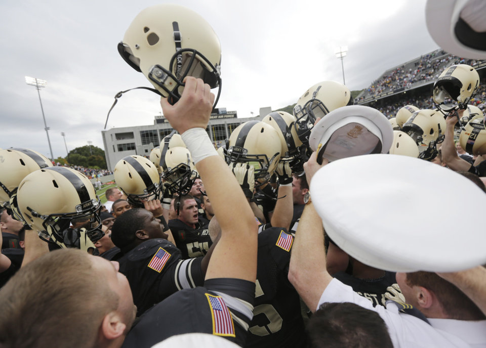 Photo -   Army players celebrate after their 34-31 win over Boston College in an NCAA college football game Saturday, Oct. 6, 2012, in West Point, N.Y. (AP Photo/Mike Groll)