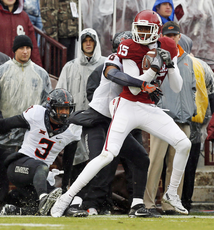 Photo - Oklahoma's Jeffery Mead (15) is tackled by Ashton Lampkin (6) next to Kenneth Edison-McGruder (3) after a catch late in the second quarter during the Bedlam college football game between the Oklahoma Sooners (OU) and the Oklahoma State Cowboys (OSU) at Gaylord Family - Oklahoma Memorial Stadium in Norman, Okla., Saturday, Dec. 3, 2016. Photo by Nate Billings, The Oklahoman