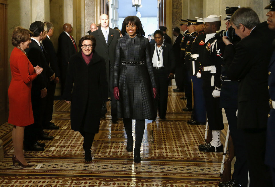 Photo - First lady Michelle Obama arrives on Capitol Hill in Washington, Monday, Jan. 21, 2013, for President Barack Obama's ceremonial swearing-in ceremony during the 57th Presidential Inauguration.  (AP Photo/Jonathan Ernst, Pool)