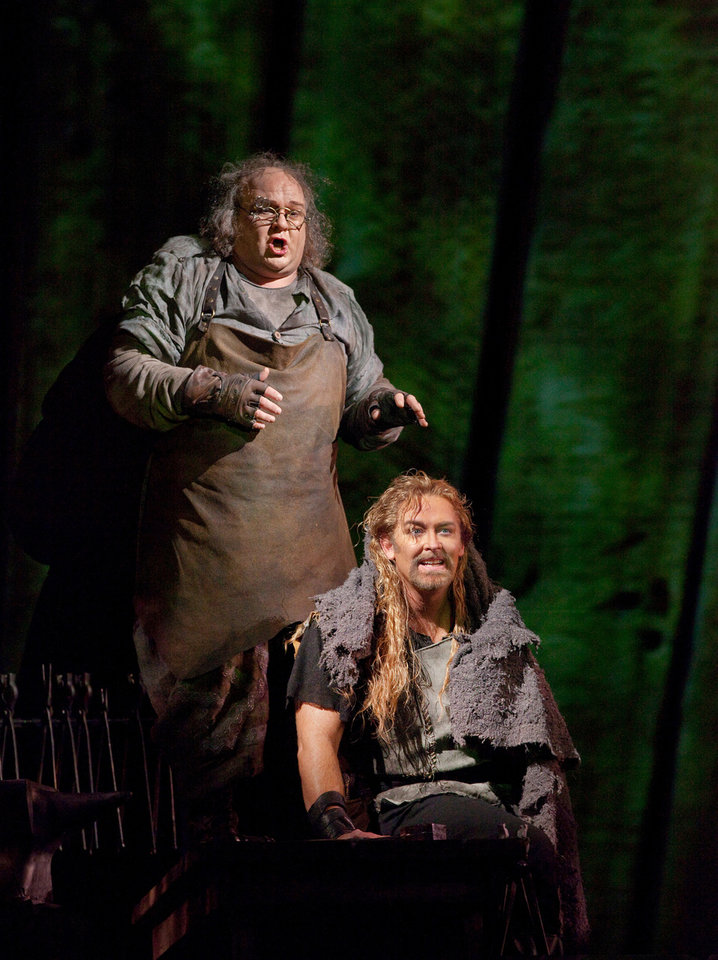 Photo -   This October 20, 2011 photo provided by the Metropolitan Opera shows Gerhard Siegel as Mime, left, and Jay Hunter Morris as the title character in Wagner's