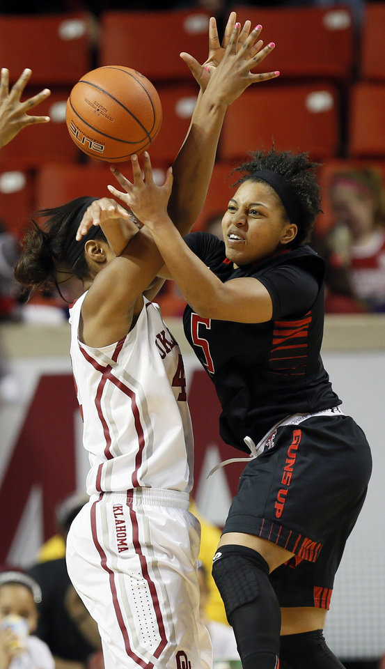 Photo - Texas Tech's Diamond Lockhart (5) passes the ball away from Oklahoma's Kaylon Williams (42) during a women's college basketball game between the Oklahoma Sooners and Texas Tech at Lloyd Noble Center in Norman, Okla., Monday, March 3, 2014. OU won 87-32. Photo by Nate Billings, The Oklahoman