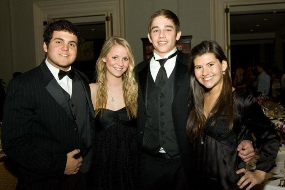 SAE'S CELEBRATE 100....Barrett Bufkin, Rachel Hartman, Jordan Perry  and Courtney Capshaw were at the Sigma Alpha Epison dinner and dance   at the Oklahoma City Golf and Country Club. Active and alumni members  celebrated the event. ( Photo by Steve Maupin.).