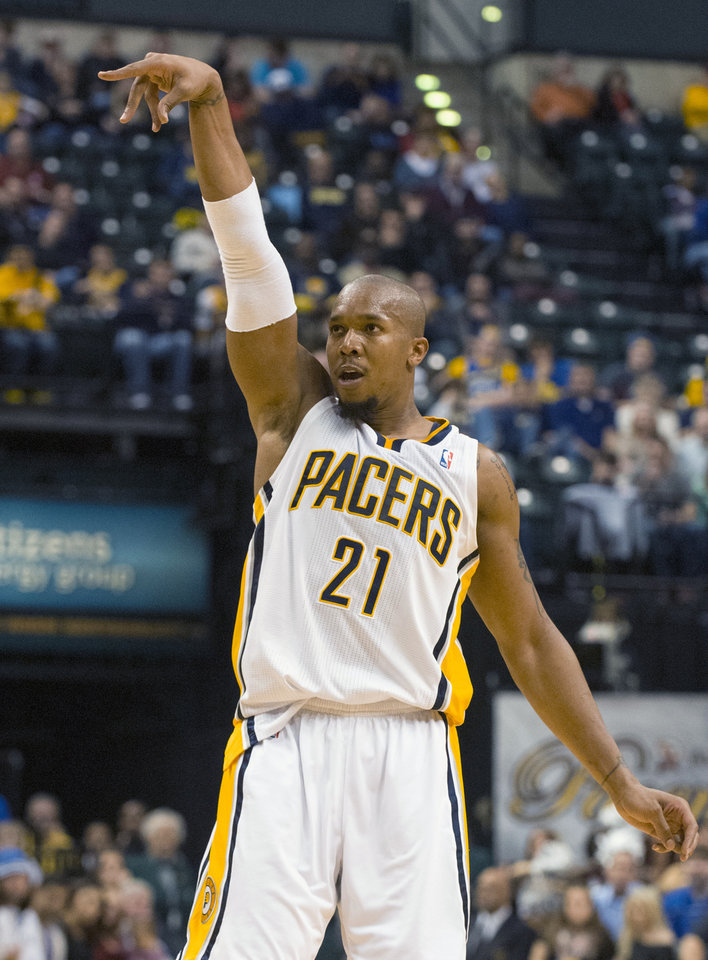 Indiana Pacers' David West (21) watches as his shot drops during the second half of an NBA basketball game against the Charlotte Bobcats in Indianapolis, Saturday, Jan. 12, 2013. The Pacers defeated the Bobcats 96-88. West finished the game with a triple-double. (AP Photo/Doug McSchooler)