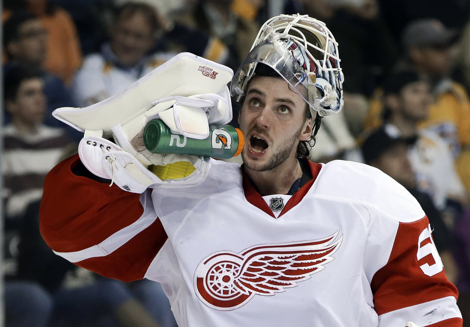 Detroit Red Wings goalie Jonas Gustavsson, of Sweden, gets a drink during a stop in play against the Nashville Predators in the second period of an NHL hockey game Tuesday, Feb. 19, 2013, in Nashville, Tenn. (AP Photo/Mark Humphrey)