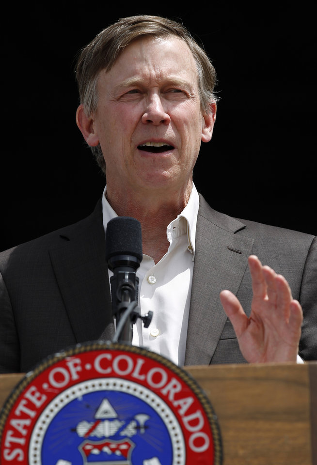 Photo - Colorado Gov. John Hickenlooper speaks during a ceremony at which he signed into law an expansion of Medicaid eligibility that's expected to add 160,000 adults to public health care assistance, at the state Capitol, in Denver, Monday May 13, 2013. The expansion is part of the federal health care overhaul. Supporters of the expansion say it will reduce health care costs in the long run, with most Republicans who voted against the bill saying the state's costs could balloon once the federal government stops paying for growing the program. (AP Photo/Brennan Linsley)
