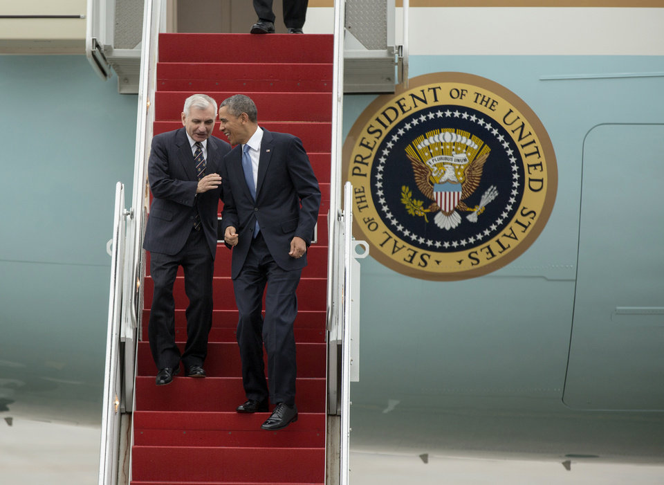 Photo - President Barack Obama and Senate Armed Service Committee member Sen. Jack Reed, D-R.I., laugh as they walk down the steps from Air Force One, upon their arrival at the Stewart Air National Guard Base in Newburgh, N.Y., Wednesday, May 28, 2014, before heading to the United States Military Academy at West Point where the president was to deliver the commencement address. (AP Photo/Philip Kamrass)
