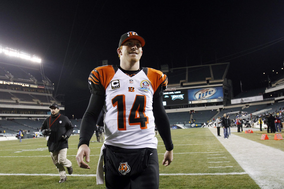 Cincinnati Bengals' Andy Dalton smiles as he walks off the field after an NFL football game against the Philadelphia Eagles, Thursday, Dec. 13, 2012, in Philadelphia. Cincinnati won 34-13. (AP Photo/Mel Evans)