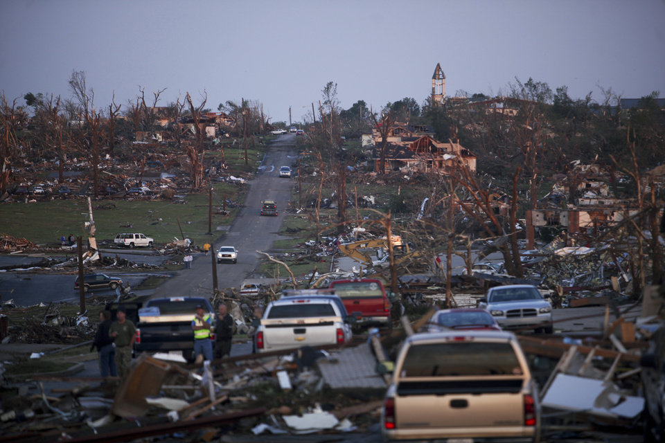 Photo - A commercial neighborhood in Joplin, Mo., is seen Monday, May 23, 2011, after it was leveled by a tornado that caused heavy damage on Sunday afternoon. The twister cut a six-mile path through the city. (AP Photo/Tulsa World, Adam Wisneski) ORG XMIT: OKTUL203