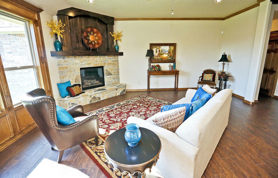 Photo - The living room of the Raywood Homes House of Hope at 3504 Sagebrush Place in the Raywood Manor addition in Yukon.  CHRIS LANDSBERGER - The Oklahoman