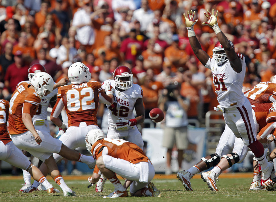 OU\'s Charles Tapper (91) tries to block a field goal by UT\'s Anthony Fera (4) during the Red River Rivalry college football game between the University of Oklahoma Sooners (OU) and the University of Texas Longhorns (UT) at the Cotton Bowl Stadium in Dallas, Saturday, Oct. 12, 2013. Photo by Chris Landsberger, The Oklahoman