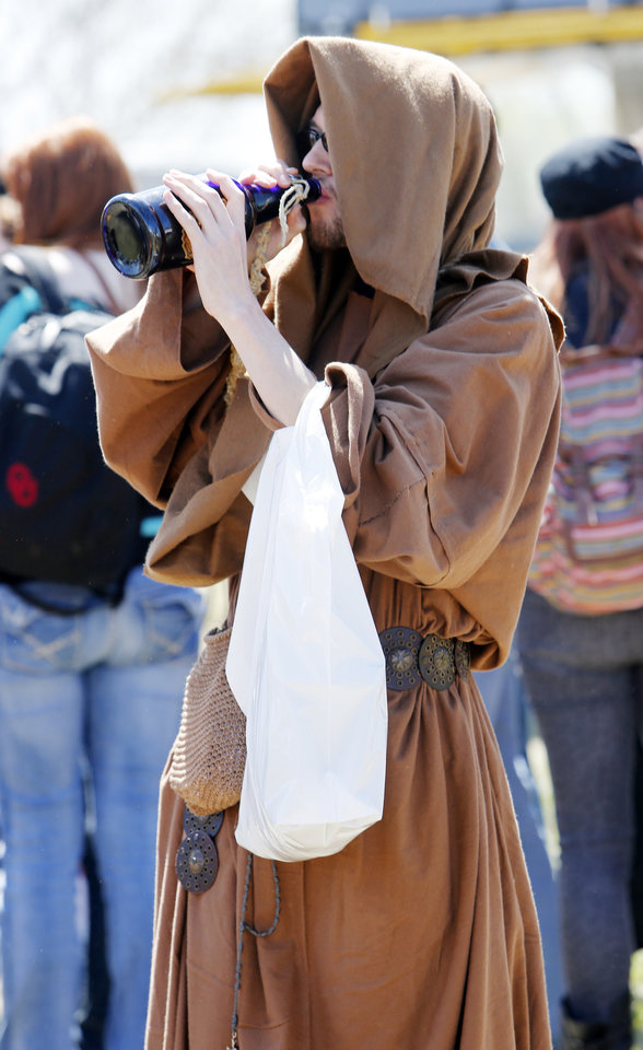 Elliott Palisade, Oklahoma City, dressed as a monk, takes a drink of Sasparilly during the Medieval Fair at Reaves Park on Friday, April 5, 2013 in Norman, Okla.  Photo by Steve Sisney, The Oklahoman