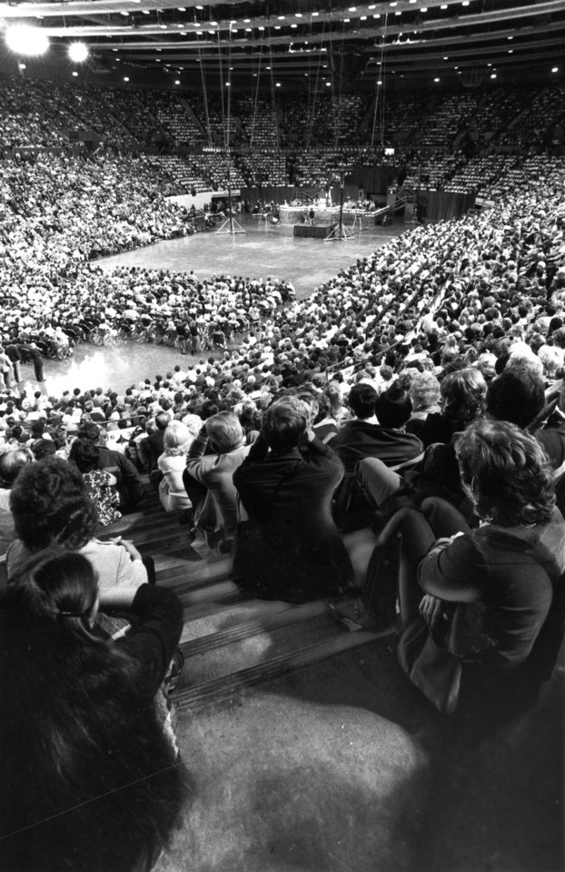 Photo - A crowd of more than 15,000 gathered in the Myriad Convention Center Sunday (10/23/1983) for the opening day of the Billy Graham Crusade.  Many people sat in aisles or stood in hallways.    Staff photo by Jim Beckel taken 10/23/1983; photo ran in the 10/24/1983 Oklahoma City Times.