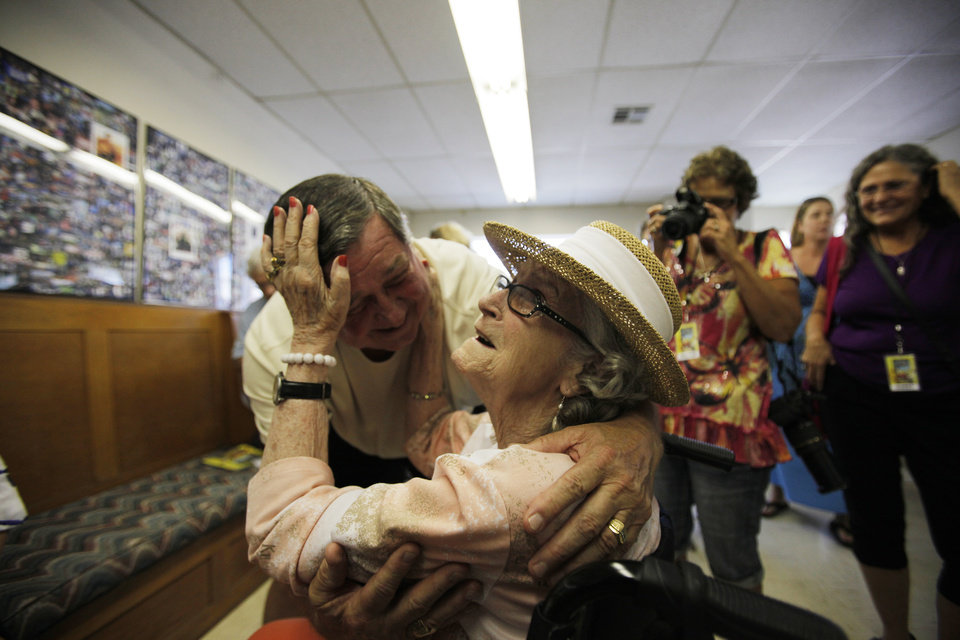 Hugh Edgmon, of Scottsville, Ariz., embraces his mother, Mary Jo Guthrie at her surprise party during the Woody Guthrie Folk Festival in Okemah, Okla., Thursday, July 12, 2012.  Photo by Garett Fisbeck, The Oklahoman