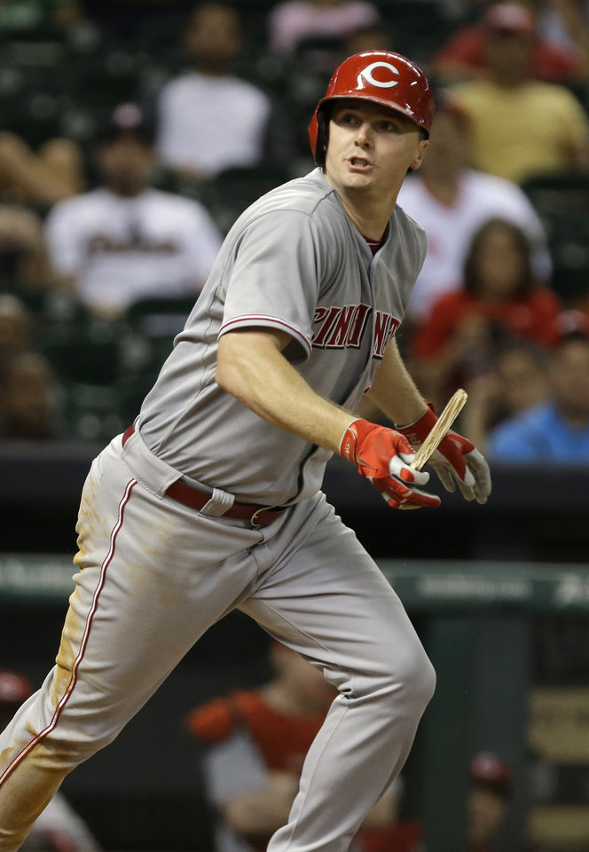 Photo - Cincinnati Reds' Jay Bruce watches the rest of his bat go into the crowd on a ground-out to the Houston Astros pitcher in the ninth inning of a baseball game Monday, Sept. 16, 2013, in Houston. The Reds won 6-1. (AP Photo/Pat Sullivan)