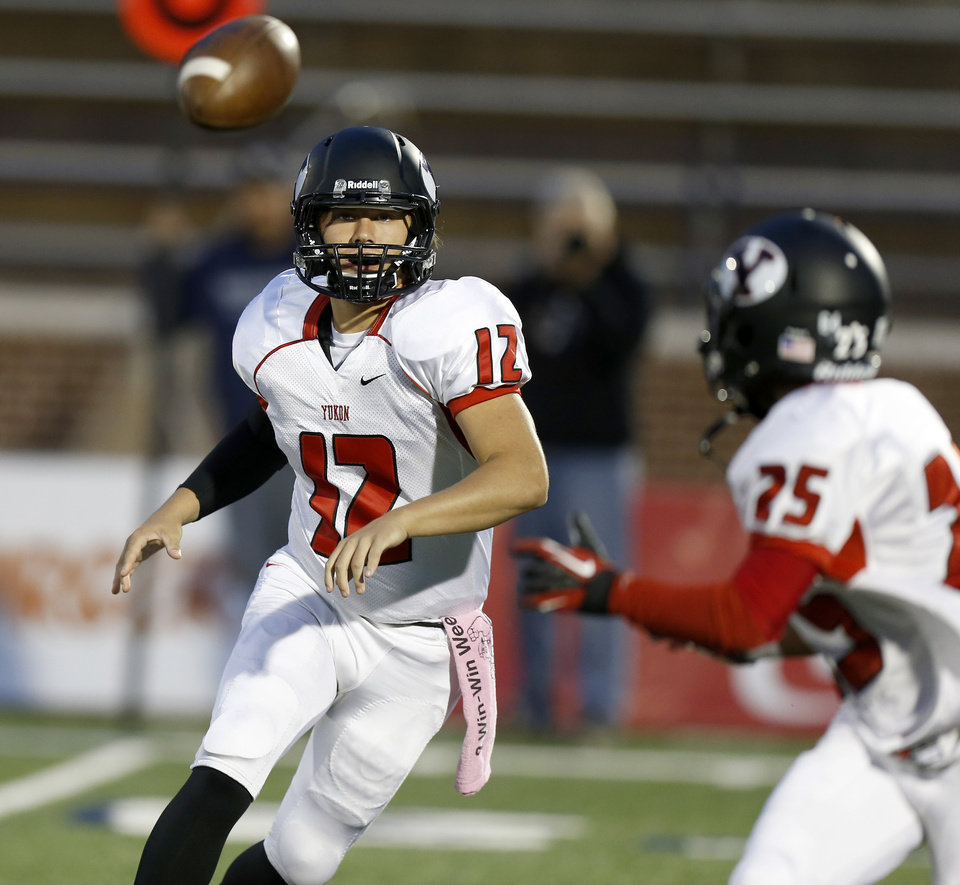 Photo - Yukon's Hayden Somerville throws the ball to Shawn Anderson during their high school football game against Edmond North at Wantland Stadium in Edmond, Okla., Thursday, October 4, 2012. Photo by Bryan Terry, The Oklahoman