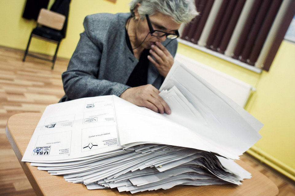 An electoral worker counts ballots in Corbu, eastern Romania, Sunday, Dec.9, 2012. Romania�s center-left government won a clear victory in Sunday�s parliamentary elections according to exit polls, but the result could inflame the personal rivalry between the nation�s top two officials and bring yet more political upheaval. (AP Photo/Bogdan Chesaru)