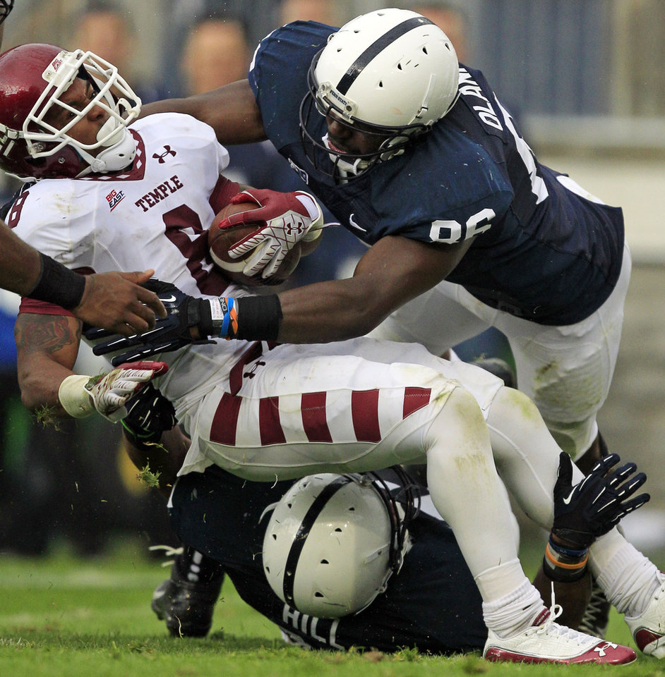 Photo -   Temple running back Montel Harris (8) is tackled by Penn State defensive end C.J. Olaniyan (86) and Penn State defensive lineman Jordan Hill (47) during the second quarter of an NCAA college football game in State College, Pa., Saturday, Sept. 22, 2012. Penn State won 24-13. (AP Photo/Gene J. Puskar)