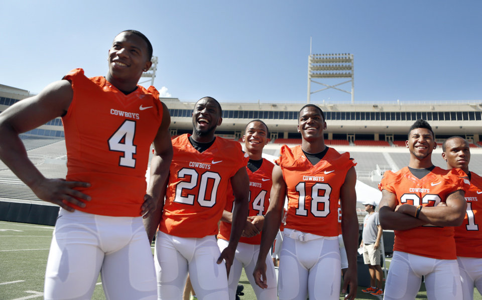 Oklahoma State football players wait to take pictures during Oklahoma State's football media day in Stillwater, Okla., Saturday, Aug. 4, 2012. Photo by Sarah Phipps, The Oklahoman