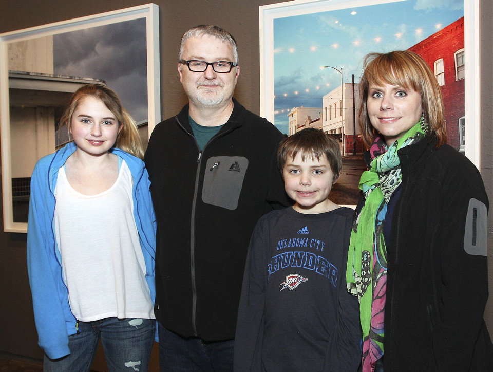 Photo - Abby, 13, Mark, Joey, 10, and Meredith Zimmerman.