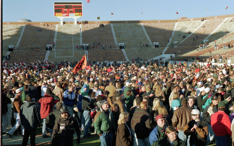 OSU football fans jam the playing field at the end of OSU's upset of OU Saturday, Nov. 11, 1995, in Norman. OSU won, 12-0. Photo by Jim Beckel, The Oklahoman