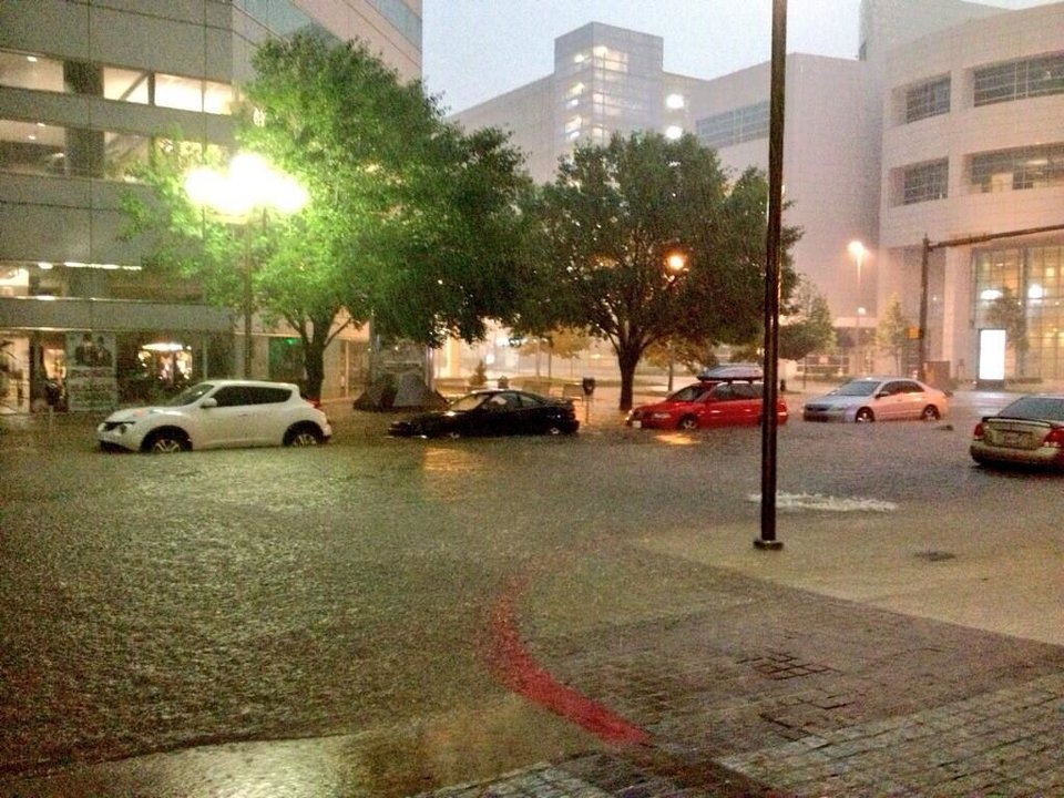 Photo - Flooding outside of the Devon Tower in downtown Oklahoma City. Photo by Josh DeLozier -- user-submitted.