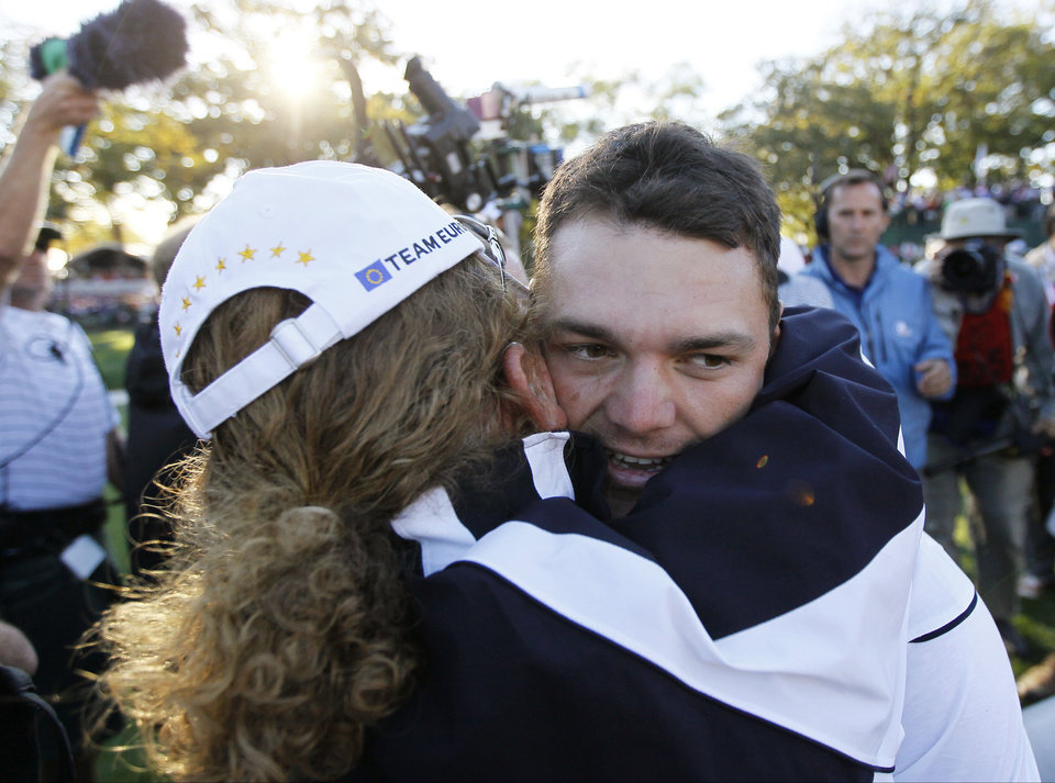 Photo - Europe's Martin Kaymer celebrates after winning the Ryder Cup PGA golf tournament Sunday, Sept. 30, 2012, at the Medinah Country Club in Medinah, Ill. (AP Photo/Charles Rex Arbogast)  ORG XMIT: PGA198