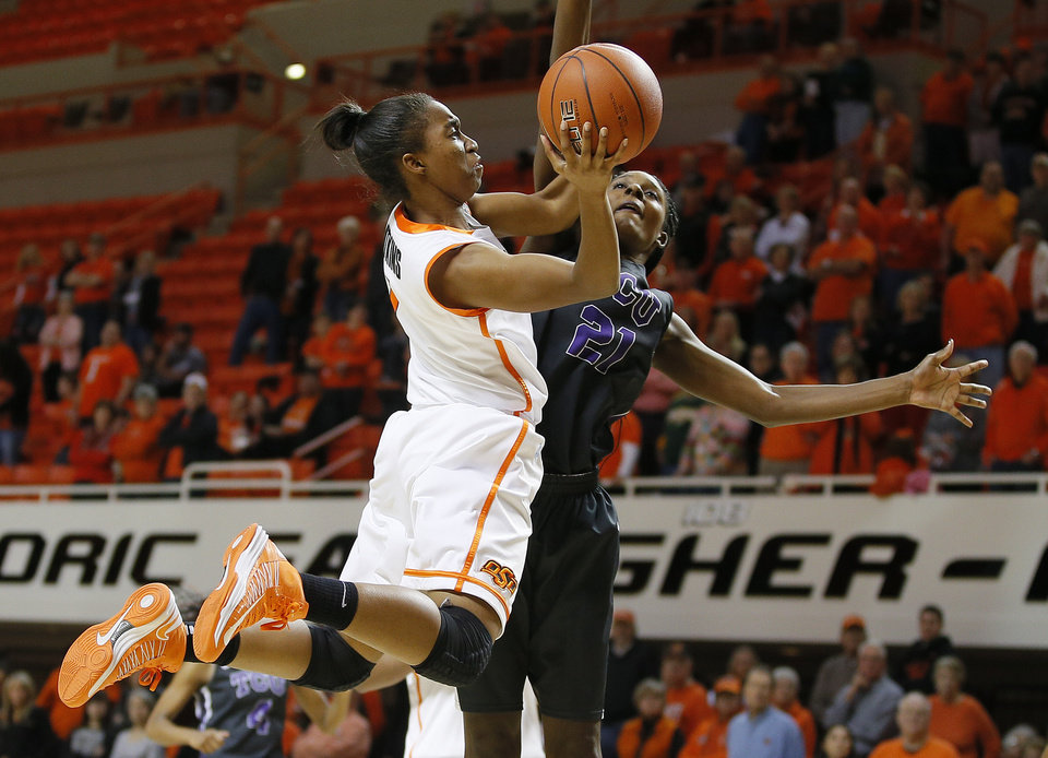 Oklahoma State's Brittany Atkins (1) goes past TCU's Latricia Lovings (21) during a women's NCAA college basketball game between Oklahoma State University (OSU) and TCU at Gallagher-Iba Arena in Stillwater, Okla., Tuesday, Jan. 14, 2014. Oklahoma State won 65-53. Photo by Bryan Terry, The Oklahoman