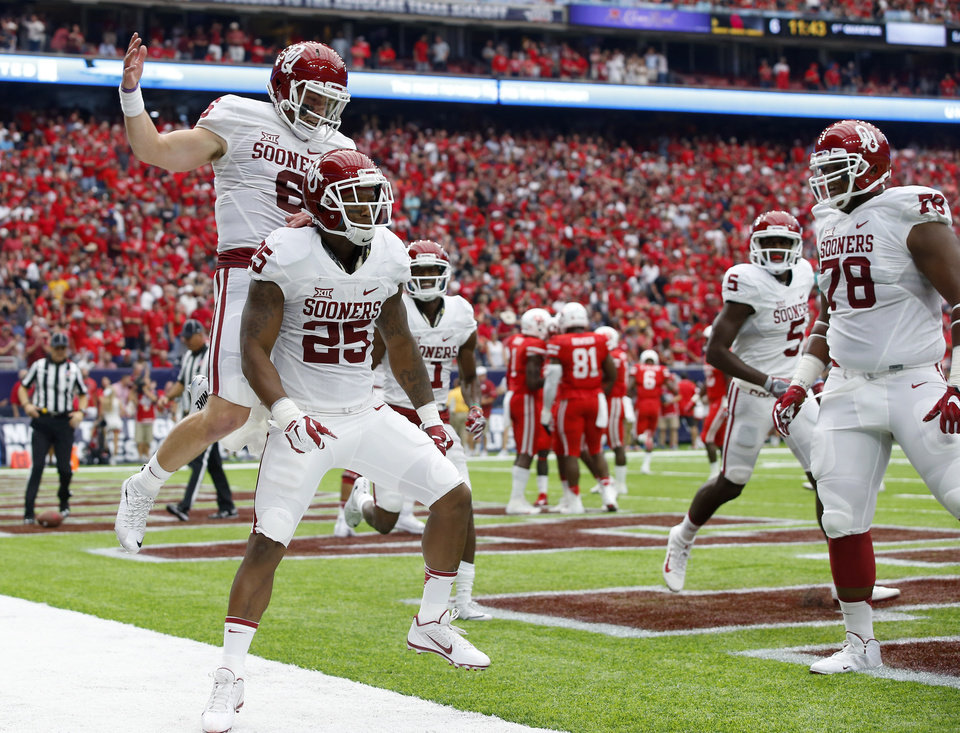 Photo - Oklahoma's Baker Mayfield (6) celebrates with Joe Mixon (25) after a touchdown during the AdvoCare Texas Kickoff college football game between the University of Oklahoma Sooners (OU) and the Houston Cougars at NRG Stadium in Houston, Saturday, Sept. 3, 2016. Photo by Bryan Terry, The Oklahoman