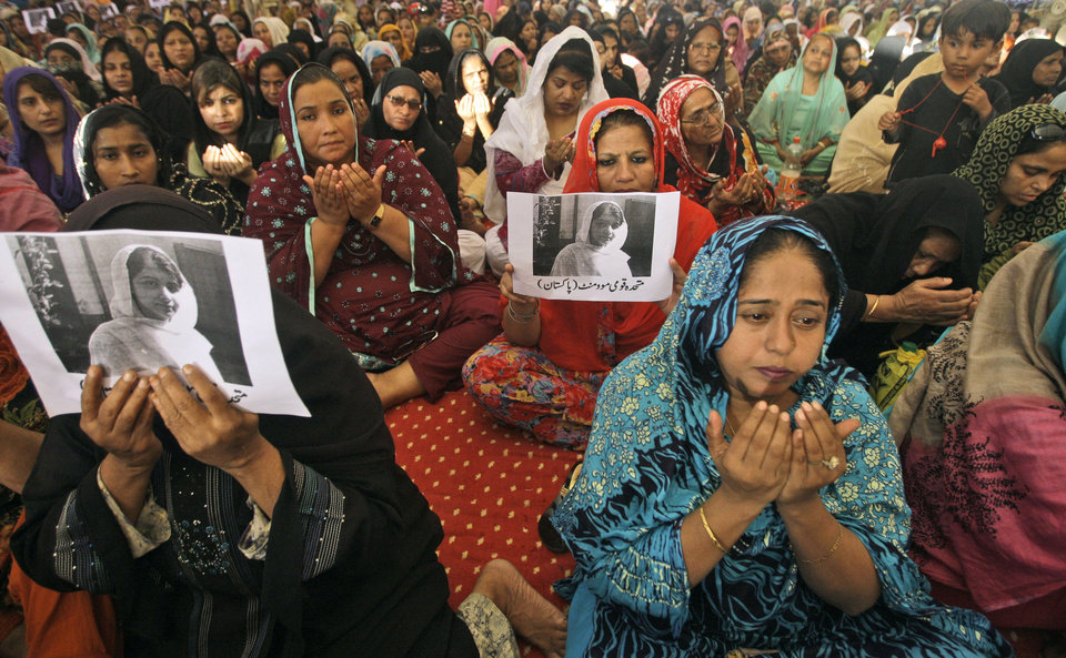 Photo -   Supporters of Pakistani political party Muttahida Qaumi Movement (MQM), chant prayers in support of 14-year-old schoolgirl Malala Yousufzai, who was shot on Tuesday by the Taliban for speaking out in support of education for women, at the (MQM)' headquarter in Karachi, Pakistan, Wednesday, Oct. 10, 2012. Pakistani doctors successfully removed a bullet Wednesday from the neck of a 14-year-old girl who was shot by the Taliban for speaking out in support of education for women, a government minister said. Writing on the poster under Malala's picture read,