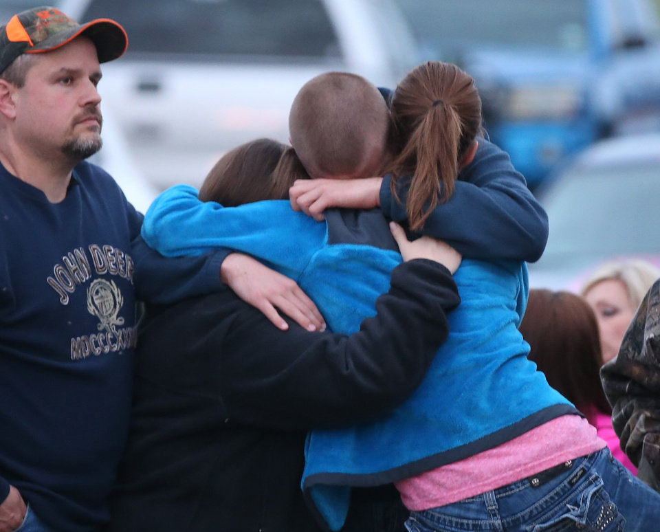 Photo - West resident hug each other during a moment of silence while attending the 4-17 Forever Forward ceremony, Thursday, April 17, 2014, in West, Texas. Today marks the one-year anniversary of the explosion. (AP Photo/Waco Tribune Herald, Rod Aydelotte)