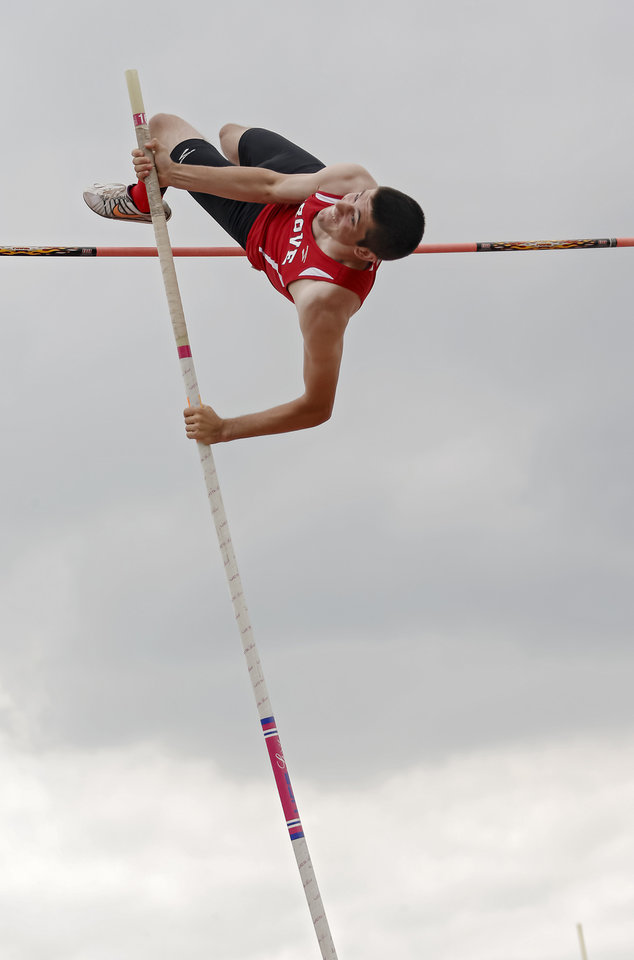Photo - Grove's Matt Jeffries competes in the pole vault during the class 5A and 6A track state championships at Yukon High School on on Friday, May 10, 2013, in Yukon, Okla.Photo by Chris Landsberger, The Oklahoman