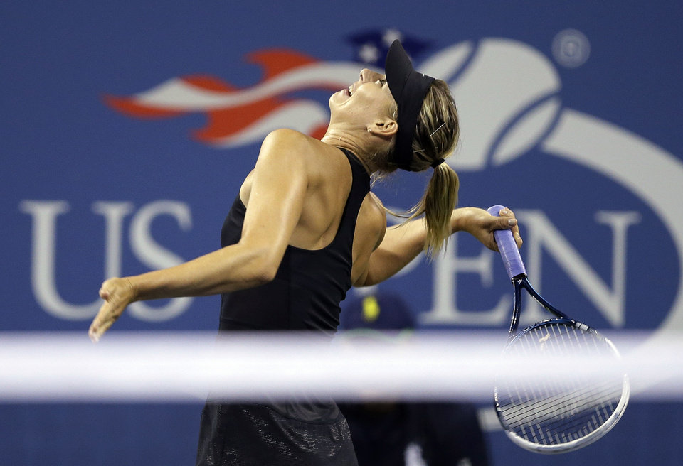 Photo - Maria Sharapova, of Russia, serves to Sabine Lisicki, of Germany, during the third round of the U.S. Open tennis tournament Friday, Aug. 29, 2014, in New York. (AP Photo/Darron Cummings)