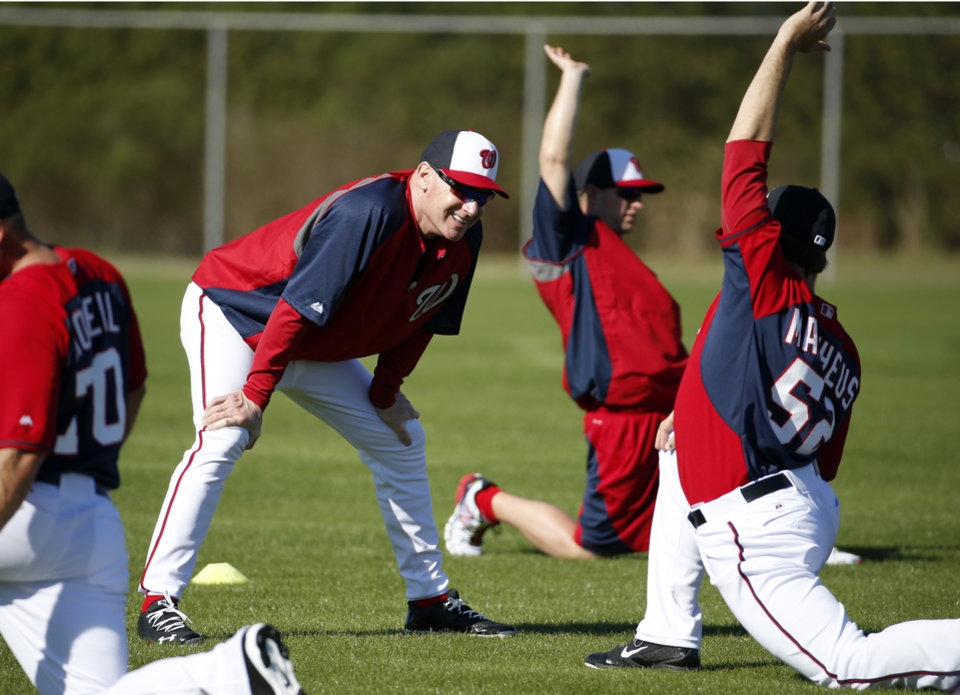 Photo - Washington Nationals manager Matt Williams, left, talks with relief pitcher Ryan Mattheus during a spring training baseball workout, Monday, Feb. 17, 2014, in Viera, Fla. (AP Photo/Alex Brandon)