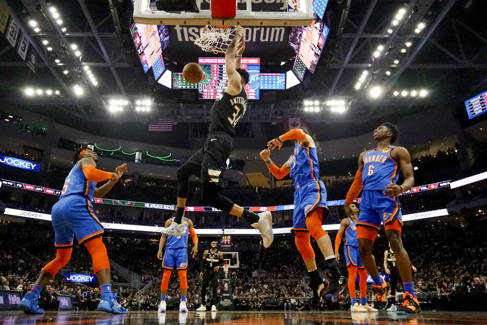 Photo - Milwaukee Bucks' Giannis Antetokounmpo dunks during the second half of an NBA basketball game against the Oklahoma City Thunder Friday, Feb. 28, 2020, in Milwaukee. (AP Photo/Morry Gash)